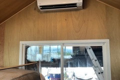 Boathouse bedroom with a Fujitsu ductless air conditioner