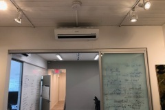 Air conditioning high wall indoor unit installed in meeting room